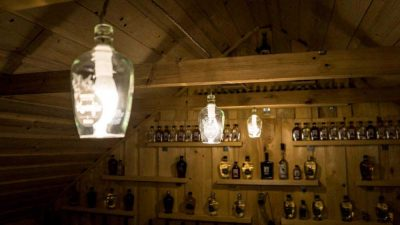 slovenian-biggest-krucefix-distillery-tours-lamps-custom-bottles-wall-of-spirits